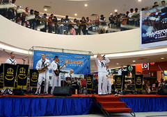 U.S. Navy 7th Fleet Band performs for local citizens at Times Square Mall in Brunei.