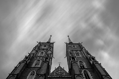 Twin towers (Soren Wolf) Tags: cathedral towers tower long exposure clouds sky symmetric symmetry black white bw wrocaw poland nikon d7100