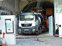 P1090430 (smith.rodney74) Tags: de61pgx tyretracks traffic bollards redwhitetape tunnel archway lookingboard highviuzjacket hardhad
