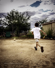 Snorri and the backyard (Sigrun Saemundsdottir) Tags: boy boys run running ball soccer soccerball outdoors outside backyard arizona sigrunsaemundsdottirphotography cloudy clouds backside runningaway playing kid kids child children youth young childhood