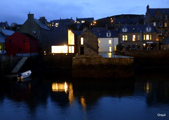 Bright Lights At The Pier Arts Centre (orquil) Tags: brightlights pierartscentre artgallery stromness town harbour watefront seaside calm sea piers old houses buildings november autumn afternoon dusk dark shadows lit windows skyline interesting reflections westmainland orkney islands scotland uk unitedkingdom greatbritain orcades beautiful lovely unusual great colourful atmospheric gloaming