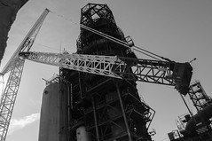 Crane between metal structures-/\ (algimantas_tirlikas) Tags: building construction crane energy factory industry montage outdoor rafinery working