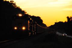 Illumination (ajketh) Tags: csx csxt 4840 sd70ace emd valrico plantcity florida fl darkness sunset sline railroad freight train coal hopper t081