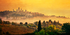 Golden Morning... (Howard Brown Photographic) Tags: san gimignano italia italy italian golden gold sunrise dawn fog mist cloud cloudsstormssunsetssunrises light sunlight photo art photoart digital panorama pano landscape cityscape tower towers torre