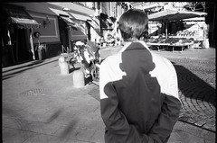 (Human Eclipse) (Robbie McIntosh) Tags: leicamp leica mp rangefinder streetphotography 35mm film pellicola analog analogue negative leicam analogico blackandwhite bw biancoenero bn monochrome argentique dyi selfdeveloped filmisnotdead autaut candid strangers leicaelmarit28mmf28iii elmarit 28mm man elmarit28mmf28iii microphen shadows light coat rolleirpx400 rollei rpx400