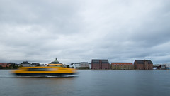 Ferry traffic in a gloomy day (HansPermana) Tags: copenhagen denmark scandinavia city cityscape oldbuilding oldtown buildings architecture cloudy gloomy autumn water kanal ship boat longexposure movement reflection