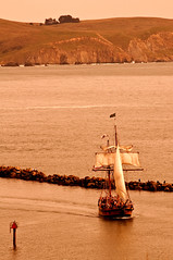 Three Sheets (TMullenaux) Tags: ocean sea sepia fisherman sailing ship flag jetty hills sail tall