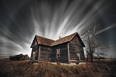 Halo on the homestead. (Fistfulofpowder) Tags: county light sky tree abandoned field grass clouds rural lost highway edmonton slow angle streak decay tripod wide halo filter adobe forgotten alberta desaturated homestead secondary stmichael hdr lamont shutterspeed lightroom longexposures superwide neutraldensity wostok nd110 tokina1116mm nikond300s