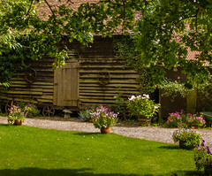 An old wooden barn in Wherwell, Hampshire (Anguskirk) Tags: old uk flowers england barn wooden village lawn eu hampshire pots tiledroof staddlestone testvalley lapboard importedkeywordtags