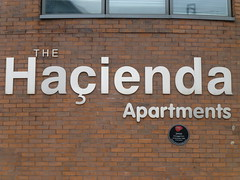The Hacienda Apartments on Whitworth Street West in Manchester (stillunusual) Tags: building architecture plaque logo manchester james 1982 gentrification hacienda prs whitworthstreet haciendaapartments crosbyhomes