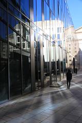 [M] Reflections - Steel & Glass (reinh_3008) Tags: architektur architecture reflection reflexion reflexionen building glass steel facade fassade morninglight marstallplatz mnchen munich shadow skateboard longboard person