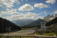 25th Hairpin (Vee living life to the full) Tags: italy leger travel touring holiday landscape rock pass pordoi sella mountain people nikond300 heathaze hairpinbend view car park road sky cloud blue