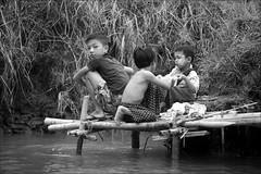 Washing by the canal (*Kicki*) Tags: children kids washing river people myanmar facesofmyanmar burma inle inlelake shanstate canal thanaka inlay candid