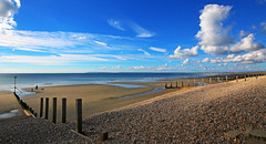 Arrival (WHO 2003) Tags: eastwittering beach shingle sand groynes clouds