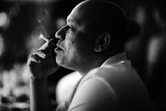 Dodgy Pleasures (N A Y E E M) Tags: umar barmate cigarette smoke light candid portrait night baikalbar hotel radissonblu chittagong bangladesh
