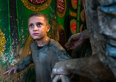Iranian shiite muslim boy after rubbing mud on his body during the kharrah mali ritual to mark the ashura day, Lorestan province, Khorramabad, Iran (Eric Lafforgue) Tags: 1people ashura celebration ceremony child colorimage commemoration culture festival horizontal hussain imamhussein iran islam kharrahmali khorramabad memorialevent middleeast mourning mud mudrubbing muharram muslim oneboyonly outdoors people persia persian pond religion religious ritual shia shiism shiite tradition traditional waistup wet lorestanprovince