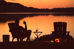 Come Out Here Dear Boy, Have a Cigar (matthewkaz) Tags: limelake lake water sunset fire campfire cigar glass beer chair chairs chris friend silhouette leelanau maplecity cedar michigan summer 2016 reflection reflections sun sky