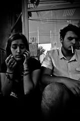 _DSC3612 (stimpsonjake) Tags: nikoncoolpixa 185mm streetphotography bucharest romania city candid blackandwhite bw monochrome cigarettes guy girl phone smoking couple boyfriend girlfriend love romance relationship
