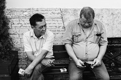(red line highway) Tags: people street photography nikon city blackandwhite black white russia stpetersburg time social documentary downtown 35mm monochrome men summer cigarette two