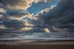 A Thousand Points of Light (betty wiley) Tags: capecod bettywileyphotography ocean storm waves beach coast coastal new england gale lightbeams rays skies stormy eastham coastguardbeach