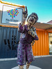 Pressing the Re:Start Button (Steve Taylor (Photography)) Tags: art sculpture container purple blue orange mauve metal newzealand nz southisland canterbury christchurch cbd city sunny sunshine sky restart mall pointing finger dressinggown 3wisemen old lady woman