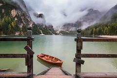 Ready to depart (Hugo Carvoeira) Tags: green boat lake lago braies prags cortina d´ampezzo wood wooden mountains fog water boattrip