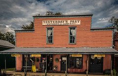 Yesterday's Past (Jims_photos) Tags: antiques antiquestore texas outdoor outside oldmemories adobelightroom adobephotoshop shadows sunnyday daytime downtown happybenchmonday jimallen lightroom cloudy clouds vintage benchmonday nopeople memories fayettevilletexas yesterdayspast