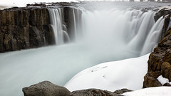 where a glacier's tears continue their flow (lunaryuna) Tags: selfoss waterfall northeasticeland riverjkulsfjllum vatnajokullnationalparknorth jkulsrgljfur rivercanyon spring season seasonalchange snow columnarbasalt longexposure le water landscape canyon beauty nature lunaryuna