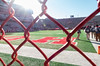 Field through the fence (Codydownhill) Tags: football game huskers big red sports portrait trophy brother dad