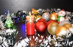 Two burning candles and Christmas balls (r8manova) Tags: merrrychristmas decoration newyear candle burn burning circle red festiv holiday black background golden photo christmastree tinsel selectivefocus christmasballs