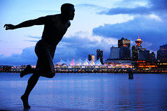 Running in Stanley Park with Vancouver City View (TOTORORO.RORO) Tags: city travel canada color reflection tourism silhouette statue skyline night vancouver lens landscape cycling mirror twilight downtown cityscape bc view britishcolumbia sony running seawall trail handheld translucent stanleypark bluehour olympics alpha canadaplace f28 slt ssm greatervancouver harrywinstonjerome a55 1650mm sal1650