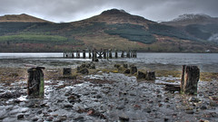The Remains (Bryan Harkin) Tags: wood old mist mountains water river pier long stones hills posts