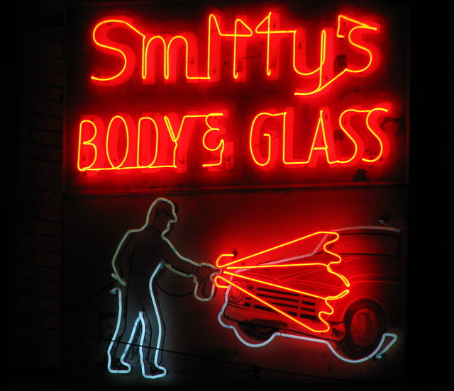 Smitty's Body & Glass neon sign at night