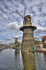 More Windmills (Jan Kranendonk) Tags: old two sky holland reflection monument netherlands dutch clouds rural town canal europe wind traditional scenic windmills historical mills molen gracht schiedam molens windmolens