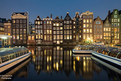 Amsterdam (robvanesch (www.robvanesch.com)) Tags: street old city travel bridge windows urban house holland reflection building brick heritage history tourism home monument water netherlands dutch amsterdam wall architecture night facade river dark golden evening boat canal ancient europe european cityscape view dusk traditional famous capital sightseeing property icon tourist medieval structure destination tradition iconic merchant