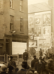 """Street scene with advertising hoardings"" but where? Corner of Summerhill and Langrishe Place!"