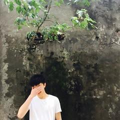 Shy boy (quizasleaf) Tags: life china trees people tree green smile sunshine square grey poetry poem shanghai buddhist chinese exhibition 1919 sunnyday youngboy shyboy