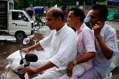 (shojaru) Tags: life street people white men rain bike dhaka bangladesh em5