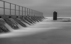 Whispers from the ocean... (ImagesByLin) Tags: ocean longexposure sea water pool monochrome clouds canon mono blackwhite cloudy whispers spillover oceanbaths merewetherbaths
