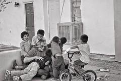 Just having fun! (Pejasar) Tags: gang bicycle orphanage children mexico guadalupe hogarparaniños hagarparaniños rancho3m fun horseplay boys