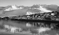 It's gonna be a bright, crispy-cold day (lunaryuna) Tags: iceland northiceland siglufjordur mountain fjord shore coast reflections weathermood light sunshine spring season seasonalchange snowcoveredmountain harbour beauty lifeinthenorth lunaryuna blackwhite bw monochrome