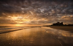 A Moment To Reflect (Captain Nikon) Tags: bamburghcastle bamburgh northumberland northeast beach castle sunrise sunrays onemanandhisdog walking reflections moody moods reflects nikond7000 sigma1020mmf4