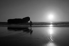 Surf's down (tamasmatusik) Tags: surf surfbeach surfin surfing surfer portugal ocean sagres algavre people monochrome bw blackandwhite noiretblanc feketefehér sony sonynex nex3n sunset sun reflections reflection contrast dark dusk november wetsand water silhouette milc faro 28mm symmetry beach waves atlantic