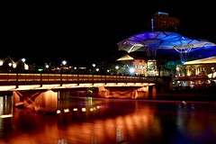 Clarke Quay (Sarah Marston) Tags: singapore clarkequay river boat lighttrail bridge hotel lights reflections sony alpha a65 november 2016