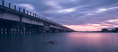 A touch of pink (lizcaldwell72) Tags: water railwaybridge sky hawkesbay newzealand sunset napier light