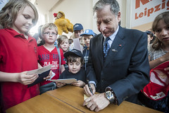 Jean Todt signs autographs for children at the Annual Summit