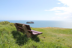 Happy Bench Monday (stepheneverettuk) Tags: uk shadow sea england sky southwest grass clouds canon island devon torquay efs1785mmf456isusm hbm 60d hopesnose happybenchmonday