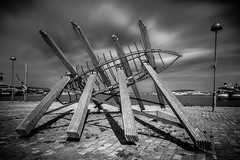 Sculpture And The Fisherman's Son (Mabry Campbell) Tags: wood longexposure blackandwhite bw sculpture art water metal canon gteborg photography eos coast harbor photo europe photographer image sweden gothenburg may coastal photograph le 100 sverige 24mm scandinavia campbell f71 goteborg mabry vstragtaland 2013 tse24mmf35l gothenburgharbor stenpiren eos5dmarkiii gteborgharbor mabrycampbell mabrycampbellcom may172013 201305170h6a1915 2410sec