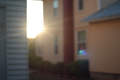 oops (jojoannabanana) Tags: houses light sunlight rainbow lensflare
