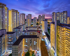 Urban Density (Scintt) Tags: travel blue homes sunset sky urban panorama skyline architecture modern night clouds buildings lights evening singapore long exposure apartments glow slow skyscrapers illumination dramatic structure flats hour shutter housing exploration hdb stitched built toa estates payoh scintillation scintt